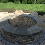 RUSTIC FIREPIT WITH BOULDER SEATING