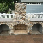 OUTDOOR FIREPLACE WITH MANUFACTURED VENEER